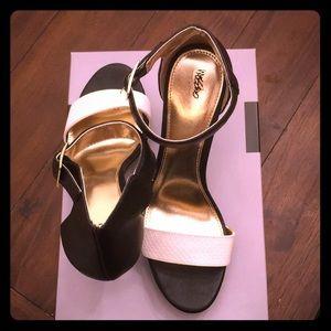 Never been worn black high heel size 9.5
